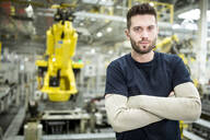 Portrait of confident worker in a modern factory - WESTF24306