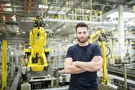Portrait of confident worker in a modern factory - WESTF24315