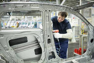 Man working in modern car factory - WESTF24327