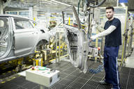 Portrait of confident worker in modern car factory - WESTF24339