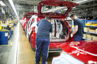 Two colleagues working in modern car factory - WESTF24357