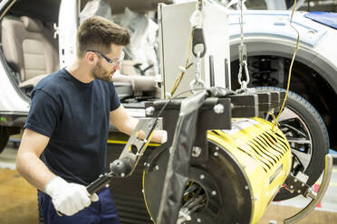 Man working in modern car factory - WESTF24378
