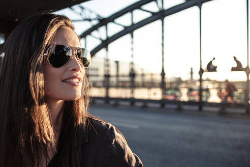 Young woman on a bridge in the evening light - WFF00134