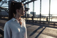 Young woman on a bridge in the evening light - WFF00146