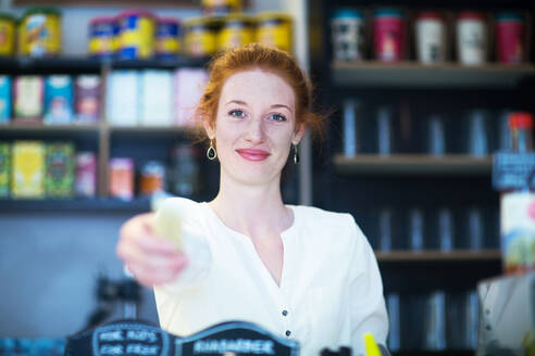 Young woman working in coffee shop - SGF02426