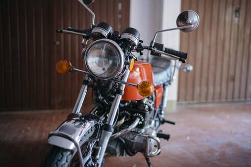 Vintage motorbike parked in garage - JPIF00233