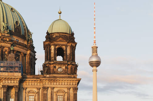 Germany, Berlin, Bell tower of Berlin Cathedral with Berlin TV Tower in background - GWF06220