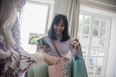Woman with shopping bags visiting friend at home - AJOF00057