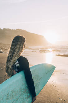Young blond surfer at the beach of Sopelana, Spain - MTBF00106