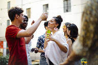 Happy multi-ethnic friends having fun during a party - SODF00163