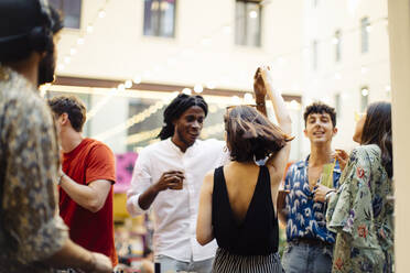Happy multi-ethnic friends having fun during a party - SODF00166