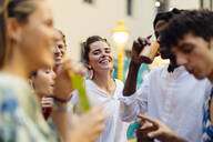 Happy multi-ethnic friends having fun during a party - SODF00169