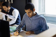 Young man working in architect's office - SODF00205