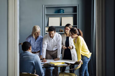Architects having a meeting, discussing a project - SODF00256