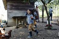 Family in a chicken pen on an organic farm - SODF00304