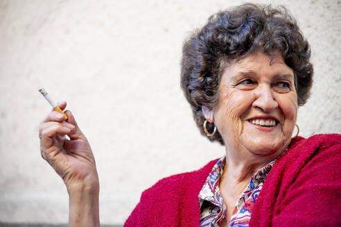 Senior woman smoking - OCMF00886