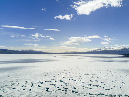 Idyllic view of frozen sea against cloudy sky - CAVF68342