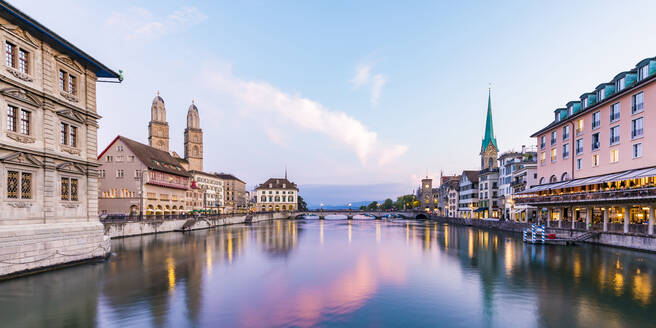 Switzerland, Canton of Zurich, Zurich, River Limmat between old town waterfront buildings at early dusk - WDF05561