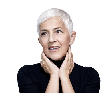 Portrait of mature woman with short grey hair and brown eyes against white background - RAMF00089