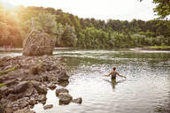 Woman in the Isar River, Munich, Bavaria, Germany - MAMF00952