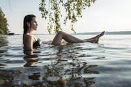 Young woman bathing in Lake Starnberg, Germany - WFF00156