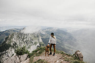 Woman with dog on viewpoint, Grosser Mythen, Switzerland - LHPF01141