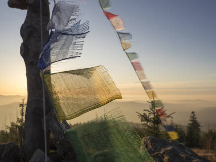 Germany, Bavaria, Prayer flags on mountaintop of Heugstatt - HUSF00107