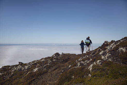 Father and daughter hiking on Ponta do Pico, Azores, Portugal - MCF00322