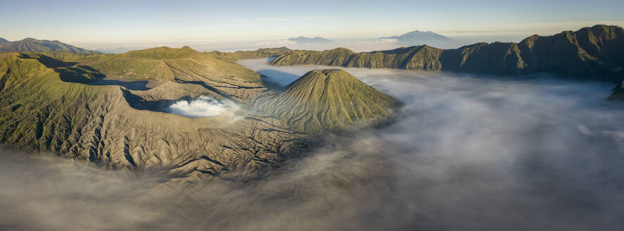 Indonesia, East Java, Aerial panorama of Mount Bromo shrouded in morning fog - TOVF00130