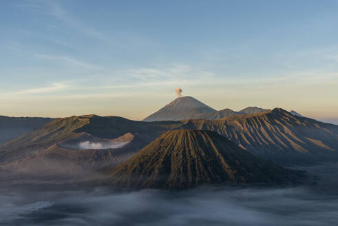 Indonesia, East Java, Aerial view of Mount Bromo shrouded in morning fog - TOVF00136