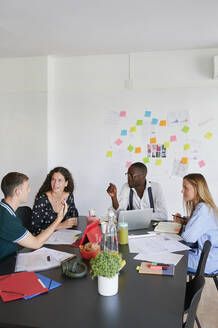 Young business people having a meeting in a modern office - IGGF01437