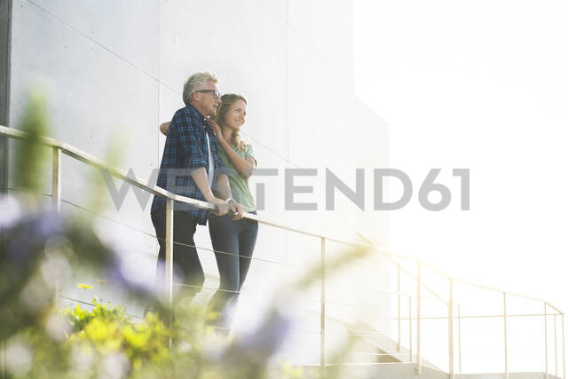 Smiling couple standing in front of their modern home - SBOF02055 - Steve Brookland/Westend61