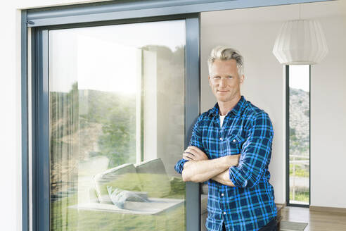 Portrait of confident man in his modern home - SBOF02064