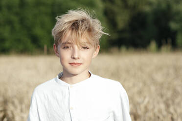 Portrait of blond boy in an oat field - EYAF00703