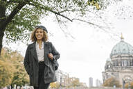 Tourist woman in the city with Berlin Cathedral in background, Berlin, Germany - AHSF01325