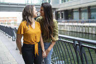 Affectionate lesbian couple in the city, London, UK - FBAF00960