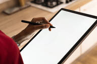 Close-up of woman using graphics tablet and stylus - GIOF07850