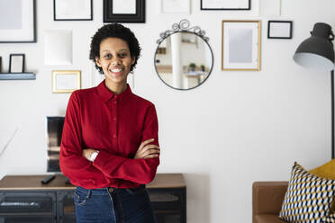 Portrait of smiling young woman at home - GIOF07853