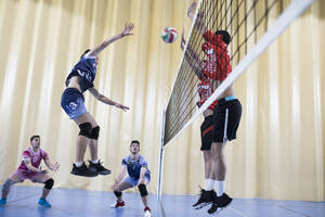 Man jumping during a volleyball match - ABZF02835