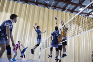 Man jumping during a volleyball match - ABZF02847