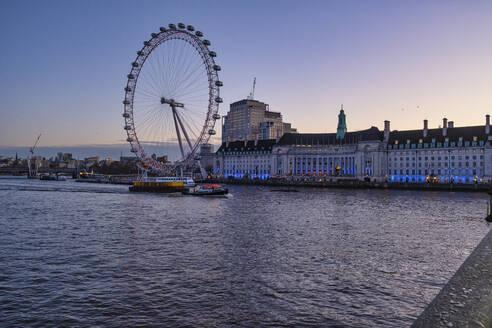 UK, England, London, London Eye and waterfront buildings at dawn - LOMF00914
