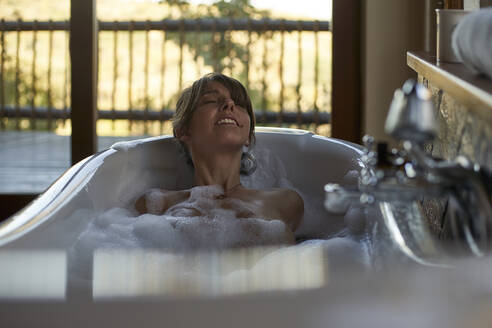 Woman having a relaxing bath in the bathtub - VEGF00836