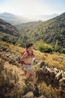 Female hiker during hike at Tavignano Valley, Corte, Haute-Corse, Corsica, France - MSUF00054