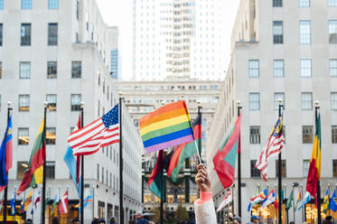 Hand waving LGBT flag in NYC, USA - JCMF00294