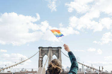 Woman waving LGBT flag in NYC, USA - JCMF00297