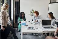 Businesswomen having a meeting in office - ZEDF02754