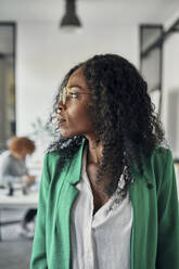 Portrait of a businesswoman in office looking sideways - ZEDF02814