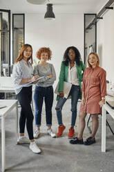 Portrait of confident female business team in office - ZEDF02817