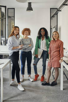 Portrait of confident female business team in office - ZEDF02817