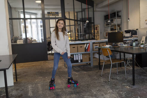 Girl rollerskating in office - GUSF02694